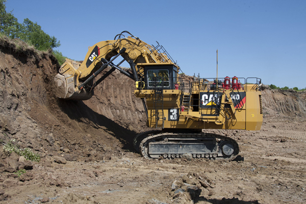 A CAT excavator machine digging for a mining operation.
