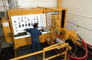 CB HYMAC employee operating control panel for machine